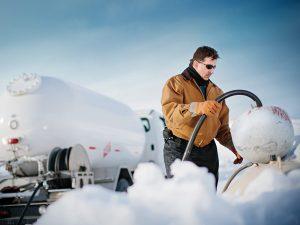 man refilling propane tank